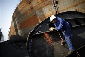 A labourer works at a shipyard in Yueqing City