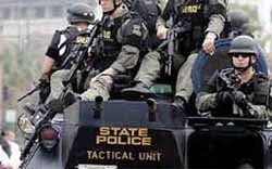 Ferguson protests put spotlight on militarized police