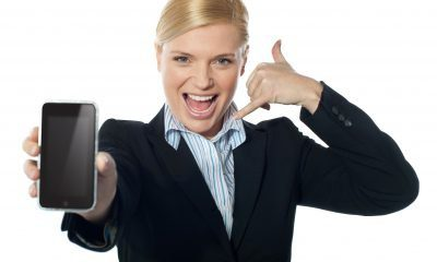 saleswoman displaying new phone