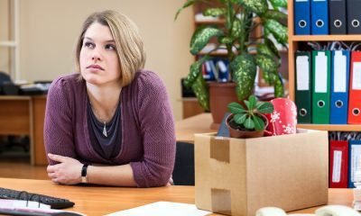 laid off woman sitting in office