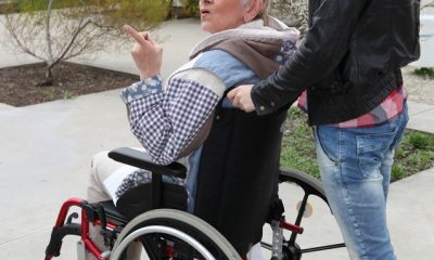 senior being pushed on her wheelchair