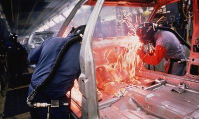 Chrysler employees weld cars