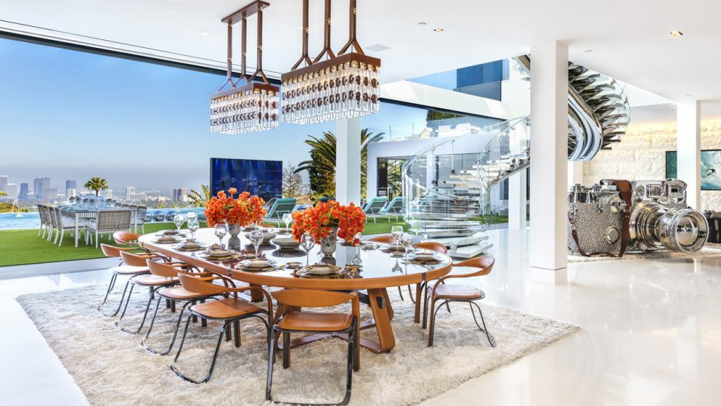 The main dining area offers views of the city and is adorned with a $2 million, 4-ton floating stainless-steel staircase.